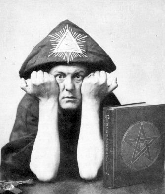 http://library.hrmtc.com/files/2012/02/crowley-with-the-hood-of-his-robe-on-his-head.jpg